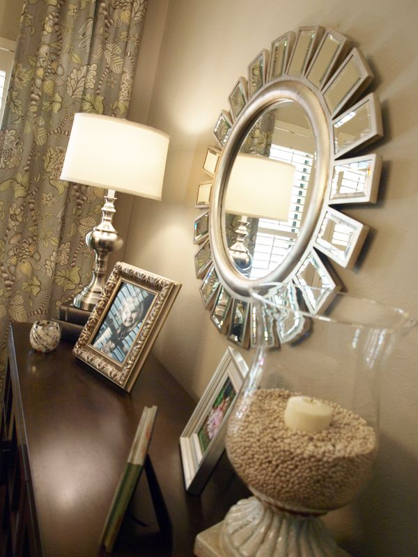 Devon Z Galleria Mirror - DIY option, Dollar Store frames, either with mirrors, or with portrait & landscape oriented photographs - or just abstract art - or wallpaper samples - glue to edges of round mirror, paint all frames to match. ~Ariel