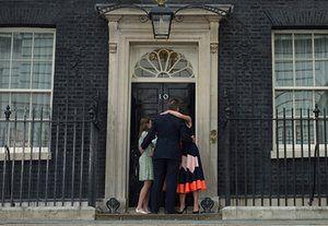 David Cameron, wife Samantha and children Nancy, Elwen and Florence hug outside 10 Downing Street