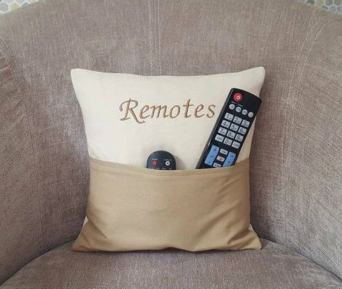 What a convenient cushion to have! This fun pillow is the perfect way to store those remote controls which are always getting lost! The cushion measures 12 by 12 and has a duck feather cushion inner. The colour of the cushion can be changed to suit, we can accommodate most colour combinations, please add a note at checkout with the colour you would like or contact us before purchasing to discuss if you would rather. This pillow would make a fun birthday gift or even a housewarming present