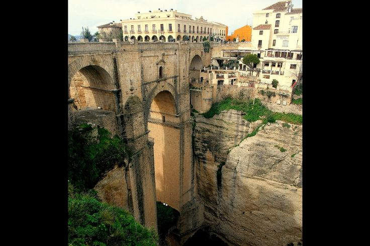 "Puente Nuevo, Spain Three impressive bridges span the gorge that cuts through the southern Spanish town of Ronda. The ""new bridge"" is the most dramatic.Photo: papalars Read more at http://matadornetwork.com/trips/photo-essay-worlds-most-impressive-bridges-vol-1/#svTM2yhxt4y2quqe.99"