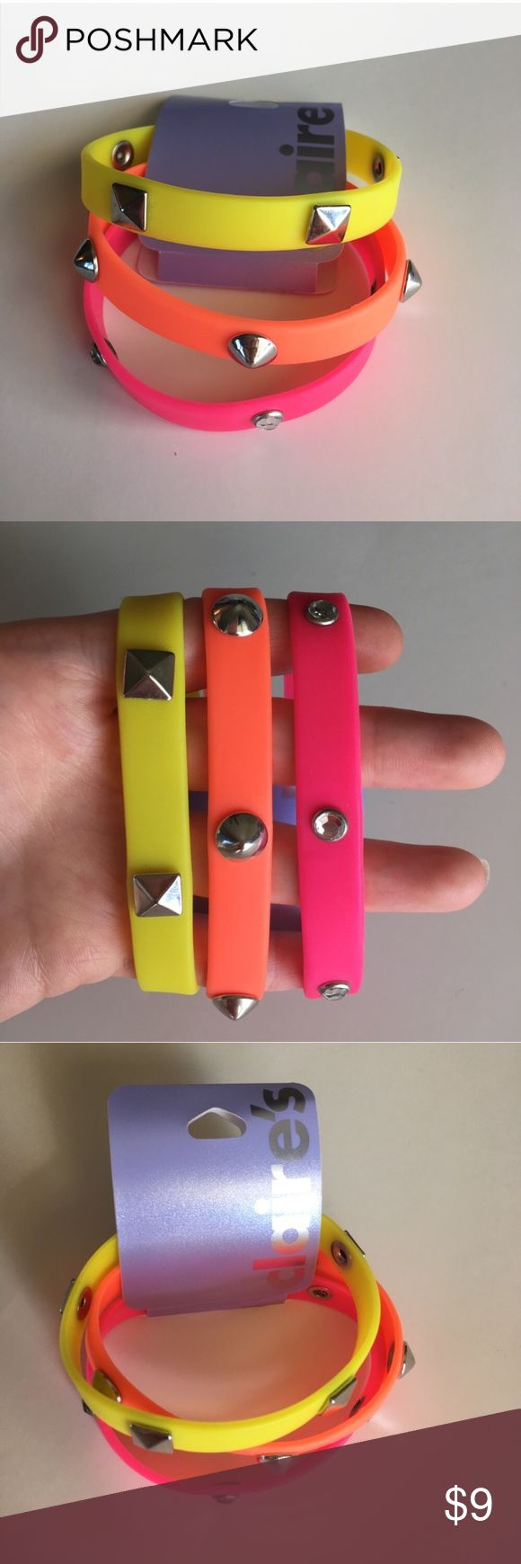 🆕3 Claire's Rubber Studded Bracelets Neon Pink Brand New 3 Claire's Rubber Silicon Bracelets  Can be worn together or separately Stackable  •Neon Yellow with triangle studs •Neon Orange with pointy studs •Neon Pink with Rhinestones studs  Please ask any questions  💲Price is firm unless bundled💲 🚫No trades🚫 📦Ask About Bundle Discounts💰 Claire's Jewelry Bracelets