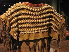 Cheyenne dress with rows of cowrie shells ...
