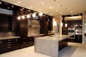 Dark walnut cabinets...love the layout of this kitchen