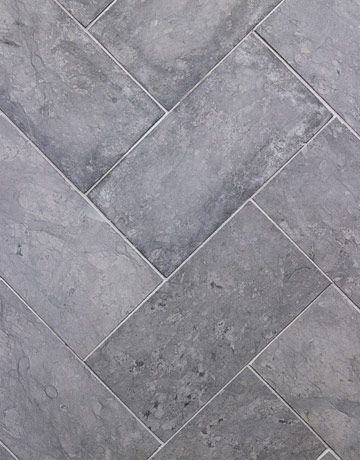 """prior pinner says: """"The honed gray limestone floor tiles almost feel like suede. I laid them in a chevron pattern to add movement. It gives you the feeling of having a soft rug underfoot."""""""