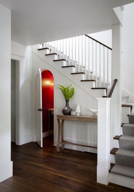 Cute under stairs bathroom, love the arched door