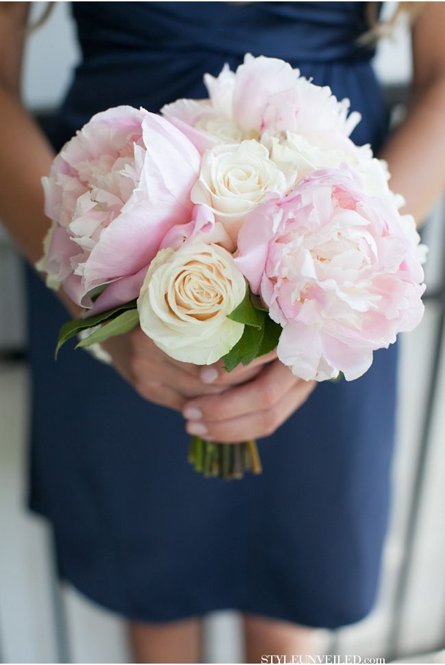 A classic pink and white bouquet that pairs excellently with this bridesmaid's navy blue dress!