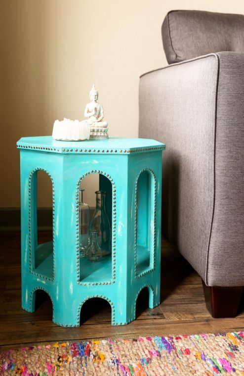 Bright and straight from India, this turquoise table boasts bold architecture and fine detailing. The handcrafted table features a distressed look and nail head accents for an inspiring vintage twist on a bohemian favorite. #earthboundtrading #homedecor #furniture #boho