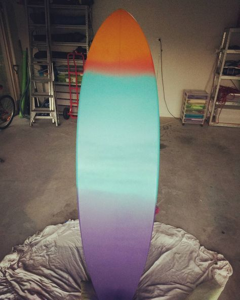 Base coat done on THE ACTUAL BOARD.. not scary..not scary at all. This side is going to be covered in sea creatures and coral etc. Still feeling a little nervous but excited too. . . #surfboard #surfart #surfboardart #sunsetcolors #spraypaint #spraypaintart #painting #excited #nervous #sketchylove