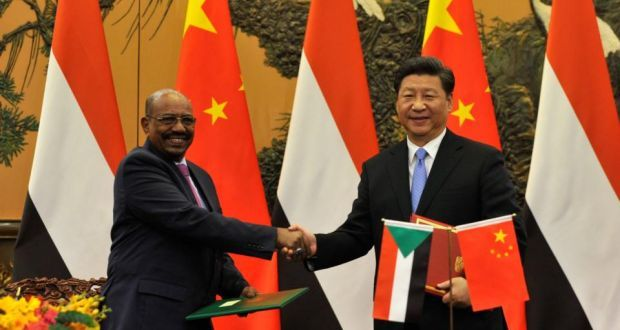 China welcomes Sudan's president , Bashir,  AN ACCUSED WAR CRIMINAL, as an 'old friend' Omar al-Bashir is accused of masterminding genocide and other atrocities in Darfur     China's president Xi Jinping shakes hands with Sudan's president Omar al-Bashir during a signing ceremony at the Great Hall of the People  in Beijing on Tuesday. Photograph:  Parker Song/GettyImages