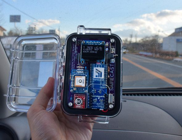 A Geiger counter built with Safecast's do-it-yourself kit reads 1.269 microseivert per hour on Route 6, the highway that borders the Fukushima Dai Ichi Nuclear Power Plant. This reading was taken just 5 km from the crippled nuclear reactor.