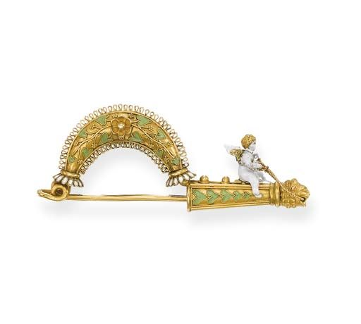AN ENAMEL AND GOLD FIBULA, BY MELILLO   The white enamelled winged Eros riding a shaft with lion's head terminal decorated with green enamel filigree vines and white enamel rosettes, circa 1875, 6.0 cm. long, in original Giacinto Melillo, Napoli, wooden fitted case