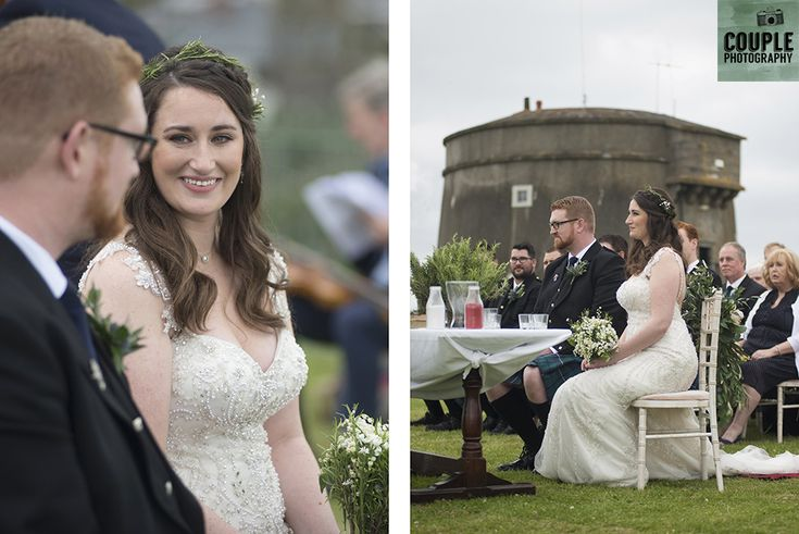 The bride & groom during their ceremony by the Martello tower Howth. Wedding in The Abbey Tavern, Howth. Photographed by Couple Photography.