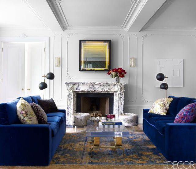 Blue, velvet sofas enliven the home of fashion designer Giovanna Randall's Fawn Galli designed Greenwich home