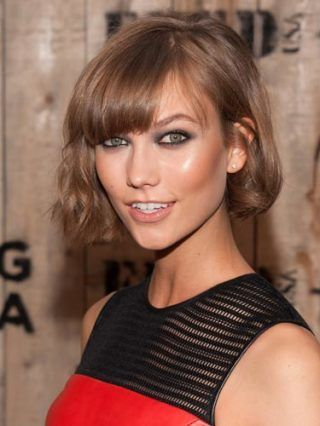 Natalie Portman's tousled bob is the hair we aspire to have, basically 'The Karlie' is THE haircut of 2013 combing a cutesy bob and side-swept fringe. Her petite features can totally take it but if yours aren't so delicate try a slightly longer length. COSMO'S HAIRSTYLE OF THE DAY COOL CELEBRITY FRINGES FRONT ROW HAIR AT FASHION WEEK
