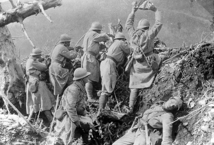 French troops throw rocks at advancing German troops from their hillside trench in the Vosges, 1916.
