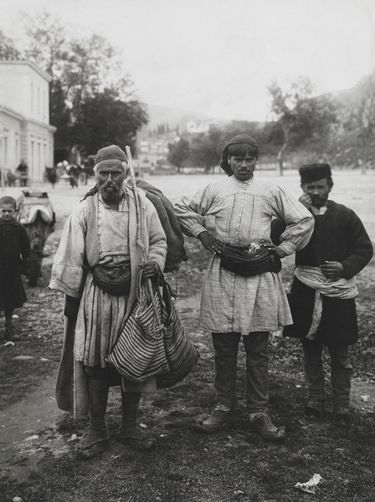 An informal group portrait of three Peloponnesian men. Navplion, Peloponnesus Peninsula, Greece. Photographer: SIMPICH, FREDERICK SR., ATELIER L. AND/National Geographic Creative