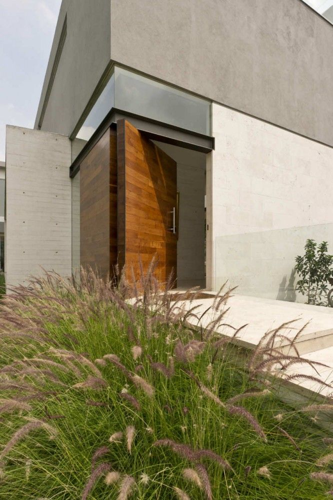 Chunky, wooden front door?   AE House / twentyfourseven COOL!!!  Thick wood, gorgeous look!