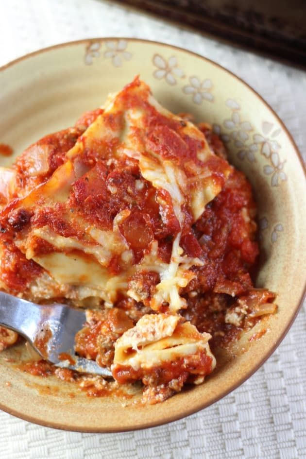 Ina Garten Lasagna is great for a crowd. Take it to your next potluck!