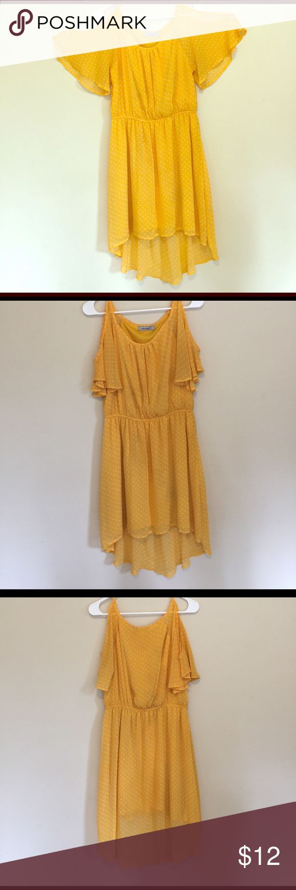 Level 8 yellow and white polka dot dress Fun, flirty sleeves. It has a high-low hem. Elastic waistband. This dress did not come with a size tag so I am guessing it is a medium. It is a pre-loved dress in great condition. Yellow with white polka dots. Bright and cheerful for a spring or summer day! level 8 Dresses High Low