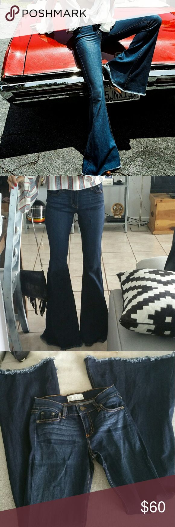 """Free People Super Flare Jeans Size 26 No longer in stores. Super flared jeans. Mid rise. Great skinny fit (they fit tight). Dark blue Ella wash. Only worn a couple of times. Mint condition. Measurements: Waist: aprox 13'' Rise: 8"""" Length: aprox 34"""" Free People Jeans Flare & Wide Leg"""