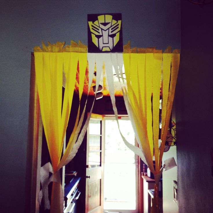 Transformers birthday party decoration, that I made. Only a rolls of yellow and white streamers and bumblebee transformers logo.