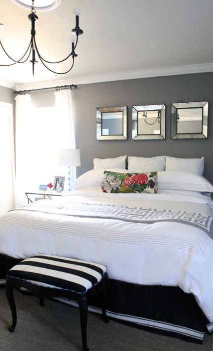 love the grey walls and that darling b&w striped bench at the foot of the bed.
