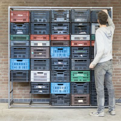Neat, simple welded steel frame and industry standard stackable plastic bins.