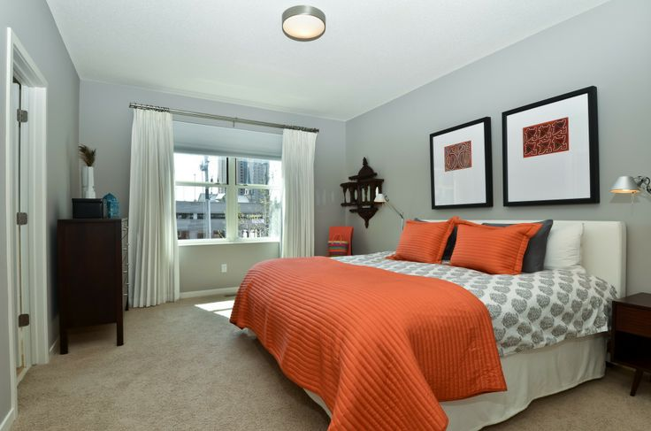 grey & orange bedroom design, frames above bed ideas, modern bedroom design, clean bedroom design, white curtains, gray paint, gray bedroom