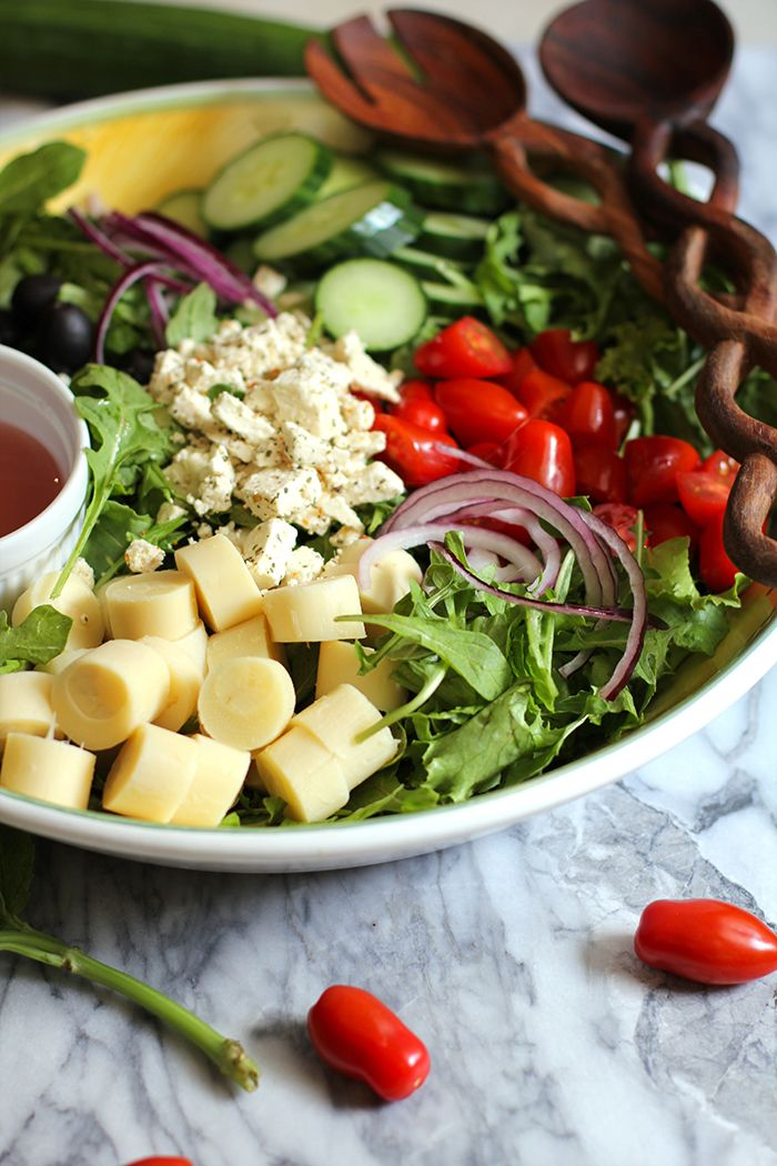 Italian Hearts of Palm Salad - fresh and vibrant and full of greens, cherry tomatoes, cucumber, red onion, hearts of palm, and a red wine vinaigrette!