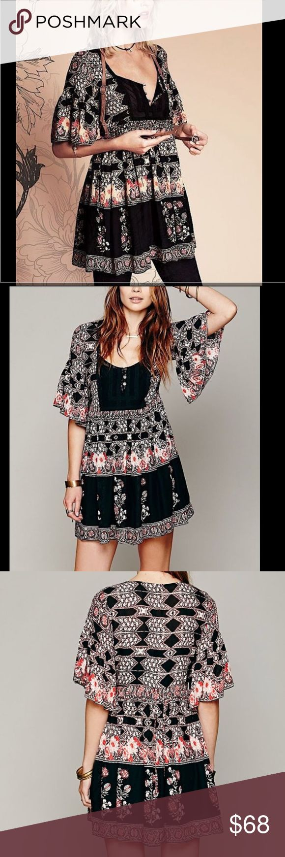 """🖤FREE PEOPLE🖤BOHO SWING DRESS🖤 This is a stunning piece from free people flutter sleeves swing dress back drawstring tie for shape definition lace button front all buttons intact pull over styling gathered waist. 😍POCKETS😍 100% rayon machine washable measurements taken flat bust 17"""" waist 15"""" length 33"""" Free People Dresses Mini"""