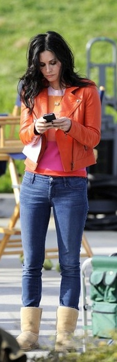 Who made  Courtney Cox's nude suede boots and orange leather jacket