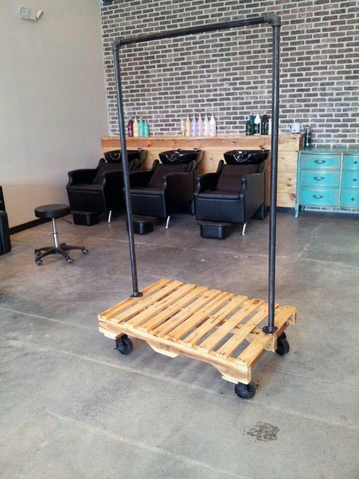 Repurposed pallet and steel pipe coat rack