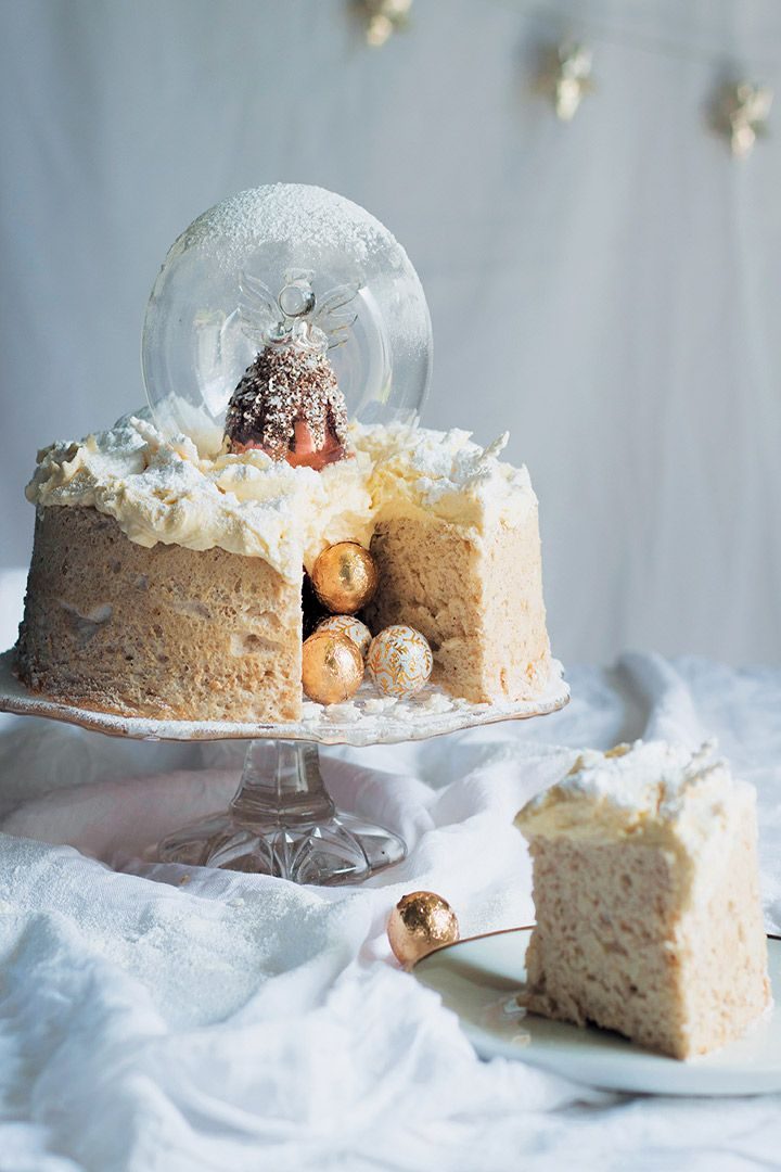 Could anything sparkle with more Christmas cheer than this Angel snow-globe cake with brandy-butter icing? This divine dessert is nothing short of heavenly. Light, sweet, and beautiful, it's a real showstopper. Happy holidays!