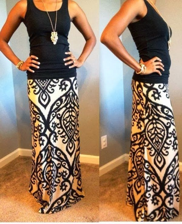 Black blouse and stylish long skirt with owl long necklace. i love this outfit