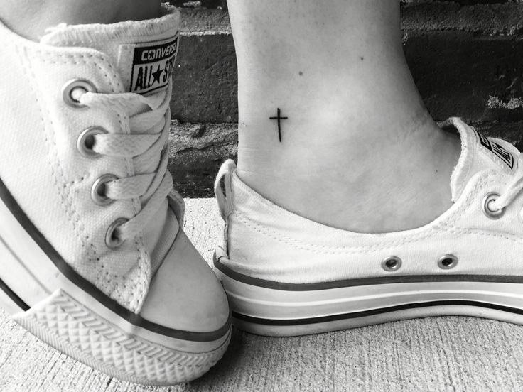 Small, dainty cross tattoo. Love the placement.