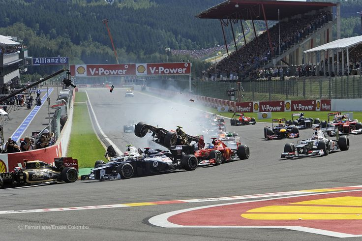 Romain Grosjean crashes into Fernando Alonso at the start of the 2012 Belgian Grand Prix at Spa-Francorchamps