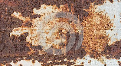 Patchy rusted metal makes a textured background.