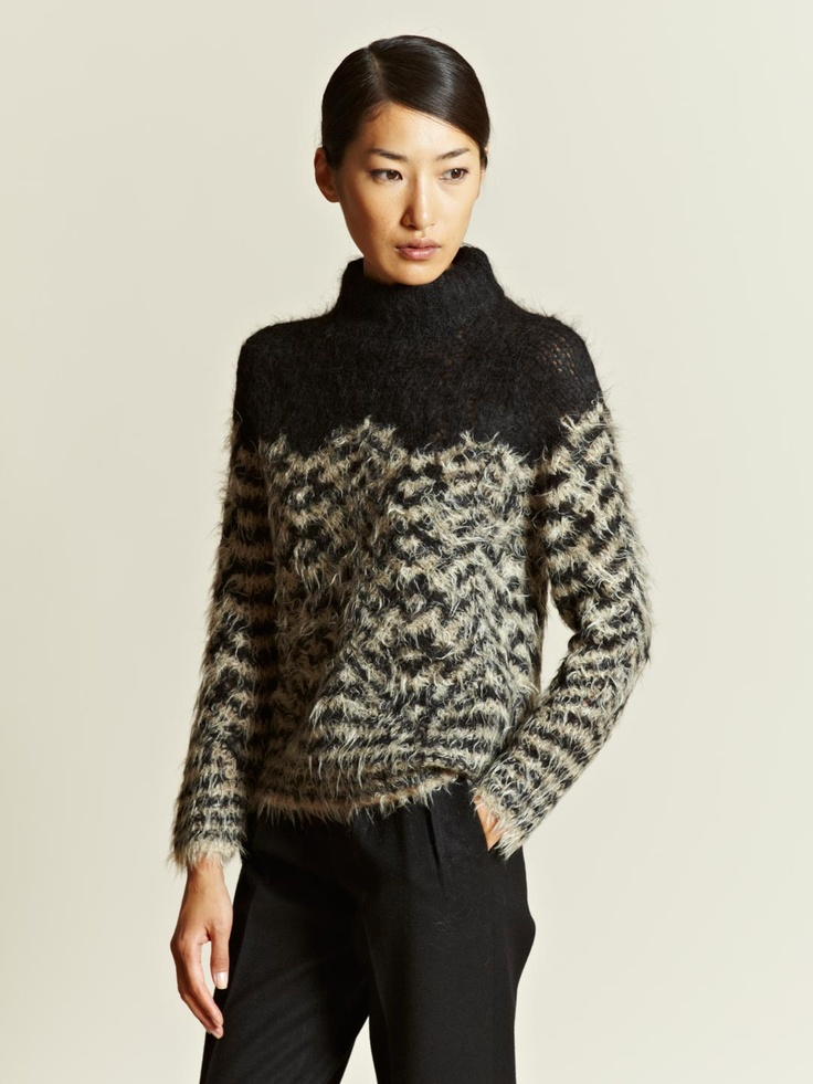 DRIES VAN NOTEN WOMEN'S MIX UP SWEATER From AW 12 Collection In Black. Crafted from wool, merino wool and alpaca blend. Silm fitting silhouette. High, raised ribbed collar. Features a cream and black zig-zag patterning below the chest and along the sleeves.