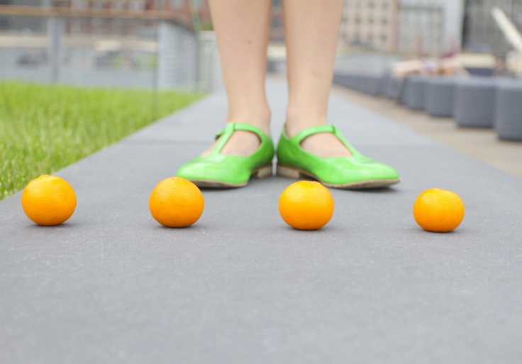 Stella with oranges & green shoes at the Seaport, NYC.