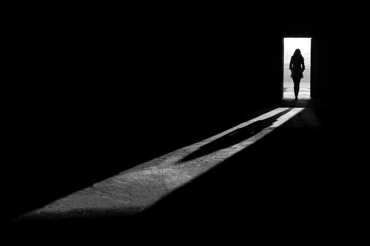 Black and white photo | Girl standing in a doorway | Shadows | exit by Kai Ziehl, via 500px