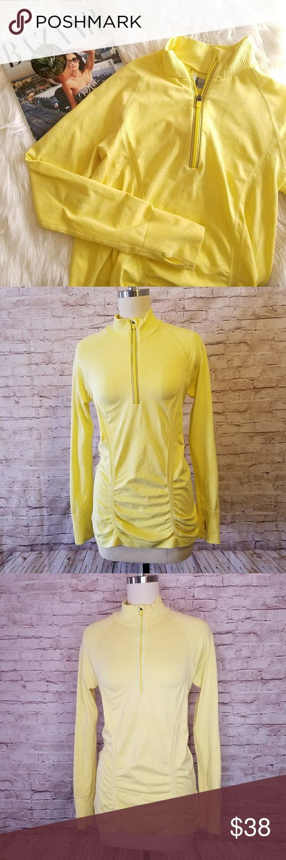 Athleta Neon Yellow 1/4 Zip long sleeve top Up for consideration is a preowned womens Athleta top. This long sleeve active top is in great overall condition!   Pit to pit approx 16in Shoulder to hem approx 25in Sleeve length approx 24in  /EC/ Athleta Tops Tees - Long Sleeve