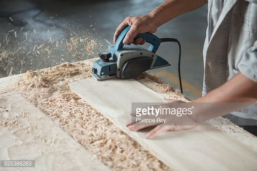 Stock Photo : Carpenter cutting wood plank in factory, Jiangsu, China