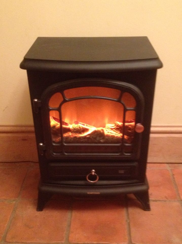 Lovely new electric log burner ...ready for the snug.