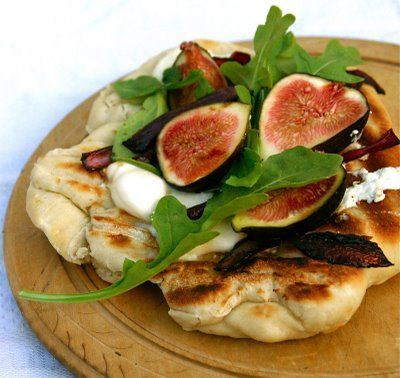 Grilled Pizza with fresh figs, freshwater mozzarella, goat cheese, Balsamic onions and Arugula.
