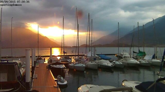 Sunrise on marina in Domaso lake Como