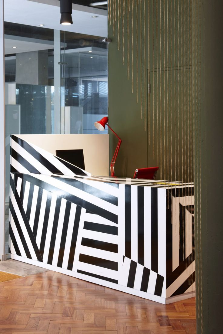 Striped Horse craft beer HQ offices designed by Haldane Martin featuring a bar counter with black and white razzle dazzle motif