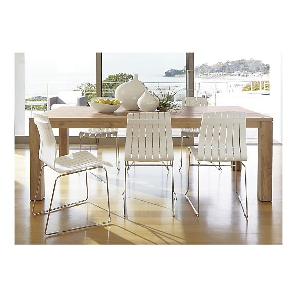 white dining chairs with wooden floor and table?