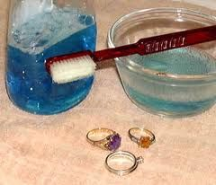 DIY Jewellery Cleaner! 1 tablespoon dishwashing detergent, 1 tablespoon baking soda, 1 tablespoon household ammonia, 3 cups warm water. Soak jewellry for 1-10 minutes. rinse and dry with a soft cloth. [don't soak pearls in this..rub them gently with the solution on a cloth]