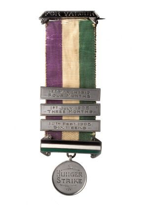 "Obverse view of Suffragette Hunger Strike medal. Silver Hunger Strike Medal with green, white, purple striped ribbon. Inscribed ""For Valour / Hunger Strike / Florence Haig"" plus the dates of her hunger strikes. Suffragettes treated the fight for the vote as a military campaign. From 1909, those who served prison terms for militancy were awarded medals for their service to the cause. Imitating military honours, hunger strike medals were decorated with enamelled tricolour bars, each bar…"