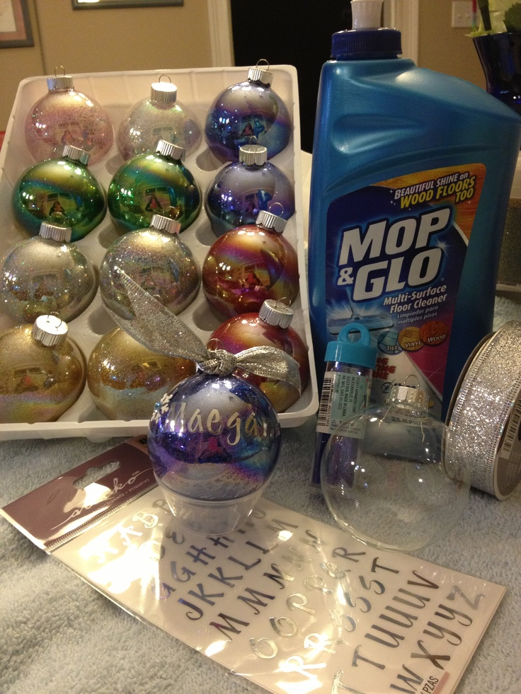Start to finish, one of the easiest and most beautiful ornaments I have ever done.   Any size/shape clear glass ball ornaments Mop & Glo with Shine Lock Extra fine glitter Optional: stick on letters/embellishments, ribbon  Directions are all over Pinterest, and here is what I did:  1. Take the top off of the ornament, squirt in Mop & Glo. Tricky to not make it foam and not get it all over the outside of the ball, have a damp rag ready :)  2. Swirl the liquid slowly as to coat all of the…
